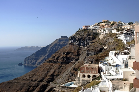 Panoramic view of Santorinis city of Fira hanging on the volcanic caldera at Santorini island in Aegean sea, Greece