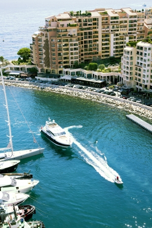 lps:  Fontvieille harbour with modern building and luxury yachts in principality Monaco Editorial