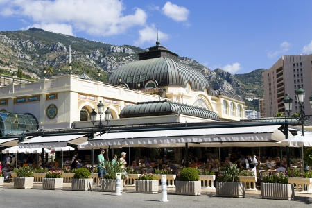 Summer patio of Cafe de Pari with wicker furniture in principality Monaco