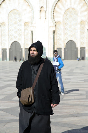 believers: Believers at walls of Hassan II Mosque in Casablanca, Morocco  It is the largest mosque in the country and the 7th largest in the world
