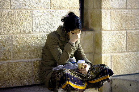 mishnah: March 18th, 2014  Woman meditates before Wall of Weeping in Jerusalem, Israel