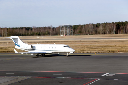 Private airplane sits down on a flight stripe in an airport Riga, Latvia
