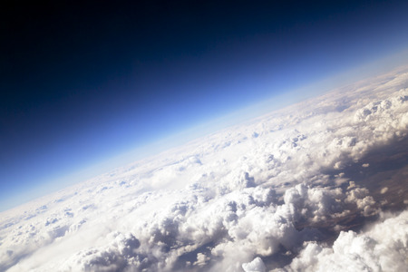 spacial: Blue sky and puffy clouds on height of 5000 m above Earth