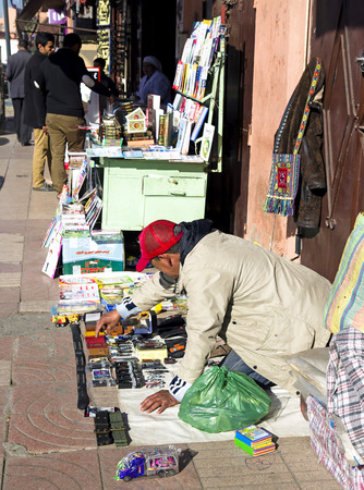 MARRAKESH, MOROCCO- DECEMBER 29, 2013  Merchants by sundries on the narrow streets of old Medina in Marrakesh, Morocco