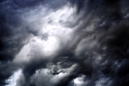 Black stormy clouds before a thunderstorm photo