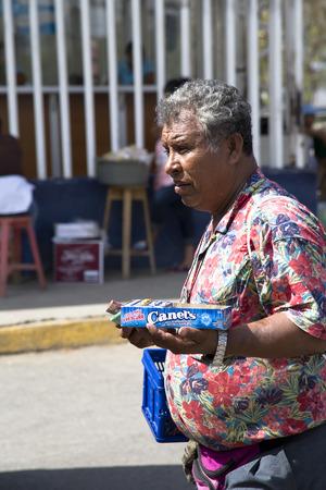 carlos: NICARAGUA, SAN CARLOS, MAY, 29, 2014 - Hispanic man sells outside candy on train station in San Carlos, Nicaragua Editorial
