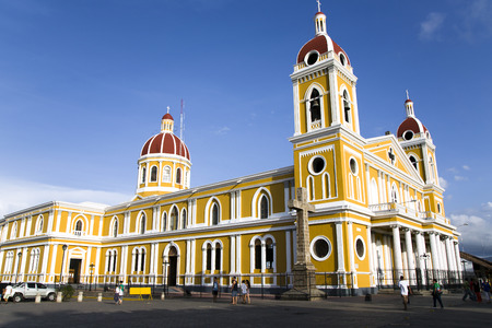 emphasizes: Granada church in Main Square, Granada, Nicaragua. A bright yellow color of paint emphasizes the Spanish Colonial architecture.
