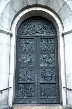 ornate door: Ancient ornate door to the medieval church in Tallinn Estonia
