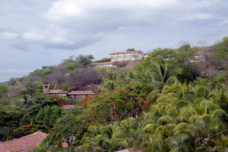 Hotel on the slope of mountain among tropical jungles in Costa Rica, Central America photo