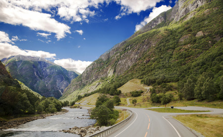 Scenic empty road and beautiful mountains in Norway. photo