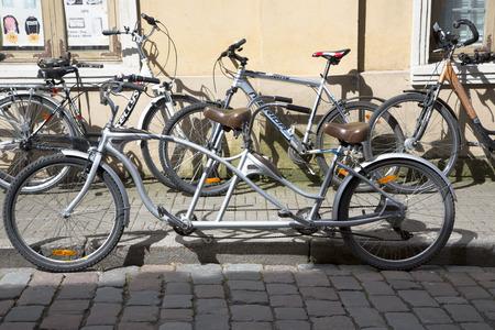 Tandem: ESTONIA, TALLINN, JUNE, 21, 2014 - Retro tandem bicycle in Old Tallinn, Estonia