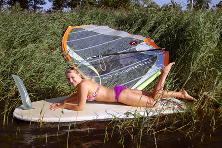 engaging: Slender blonde is glad to engaging in windsurfing