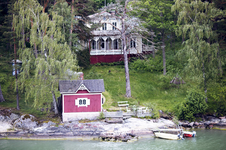 peacefull: Cottage with a bath-house ashore the Baltic sea in the Stockholm archipelago, Sweden Stock Photo