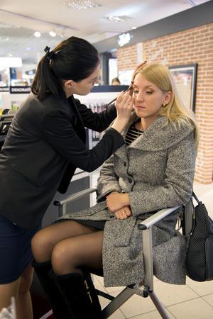 visagiste: LATVIA, RIGA, FEBRUARI, 14, 2015 - Professional visagiste does a make-up to a model in a studio ForEver in Riga, Latvia