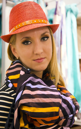 Charming lady in a orange hat and the striped scarf photo