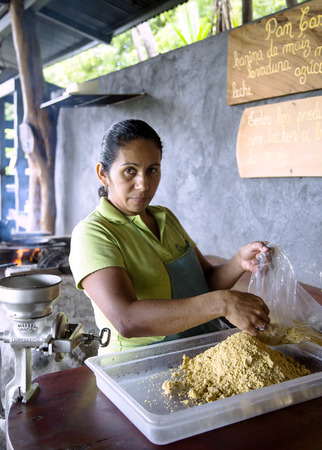 COSTA RICA CENTRAL AMERICA MAY 27 2014: Woman prepares from corn flour tortillas in the province of Guanacaste Costa Rica