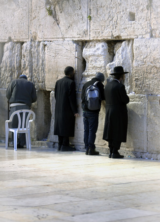 hassid: ISRAEL JERUSALEM MARCH 18th 2014: Jews being prayed at the Western Wall in Jerusalem Israel. The Old City is listed as UNESCO World Heritage site since 1981