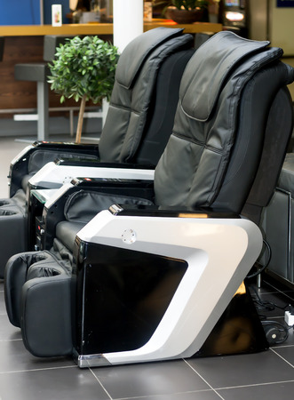 headrest: Two electric leather comfortable massage chairs Stock Photo