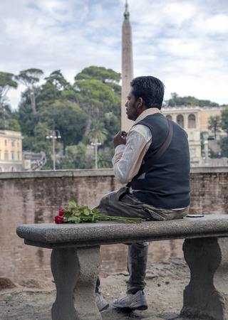 rendezvous: ITALY, ROME, OCTOBER, 28, 2014 - Latin man in expectations of rendezvous on Peoples Square Piazza del Popolo, Italy. Editorial