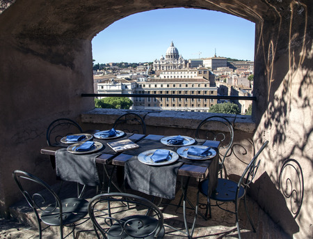 verandah: View from the verandah of summer cafe to the tower of Saint Angelo on Papal Basilica of Saint Peter Stock Photo