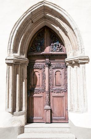 ornate door: Ancient wooden ornate door to the medieval church in Tallinn Estonia