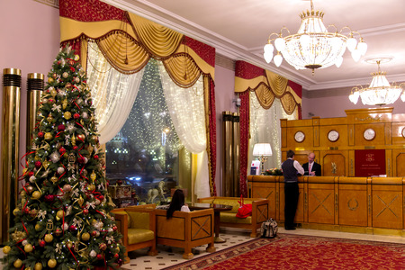 combines: RUSSIA, MOSCOW, DECEMBER, 30, 2014 - Interior of National Hotel in Moscow, Russia. Design combines renaissance and classical architecture with modernist decorative elements in a style that was typical of Moscow at the turn of the century.