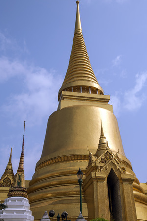 known: Wat Phra Kaew, also known as the Temple of the Emerald Buddha, that also includes the former residence of the Thai monarch, Bangkok, Thailand. Stock Photo