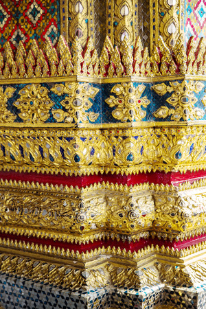 includes: Decorative patterns in Wat Phra Kaew, also known as the Temple of the Emerald Buddha, that also includes the former residence of the Thai monarch, the Grand Palace. Bangkok, Thailand. Stock Photo