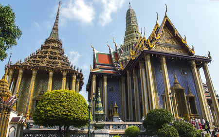 includes: THAILAND, BANGKOK, MARCH, 15, 2015 - Wat Phra Kaew, also known as the Temple of the Emerald Buddha, that also includes the former residence of the Thai monarch, the Grand Palace. Bangkok, Thailand. Editorial