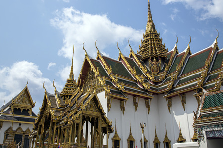 includes: Wat Phra Kaew, also known as the Temple of the Emerald Buddha, that also includes the former residence of the Thai monarch, Bangkok, Thailand. Stock Photo