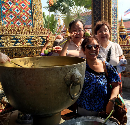 opening up: THAILAND, BANGKOK, MARCH, 18, 2015 - Ceremony of ablution by the sanctified water by the not opening up buds of lotus in Wat Phra Kaew, also known as the Temple of the Emerald Buddha, Bangkok, Thailand Editorial