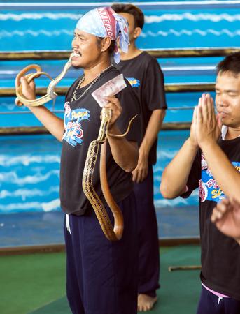 charmer: THAILAND, BANGKOK, MARCH, 26, 2015 - Charmer of snake on attraction in Million Years Stone Park Pattaya Crocodile Farm in Pattaya, Thailand