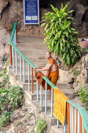 wet clothes: THAILAND, PATTAYA, MARCH, 26, 2015 - Buddhist monk spreads wet clothes in Tiger Temple in Wat Pa Luangta Bua Yannasampanno Forest Monastery, Kanchanaburi, Thailand.