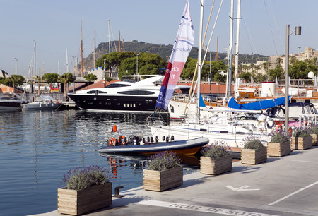 hosted: SPAIN, BARCELONA, JUNE, 27, 2015 - View of luxury yachts at Port Olympic in Barcelona, Catalonia. Located east of the Port of Barcelona, it hosted the sailing events for the 1992 Summer Olympics.
