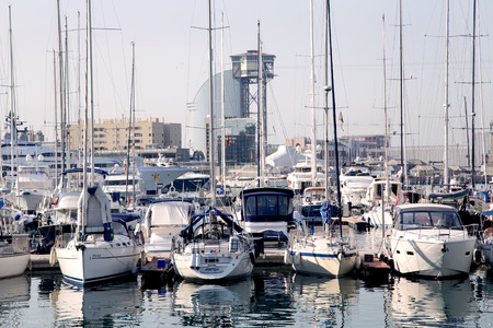 summer olympics: SPAIN, BARCELONA, JUNE, 27, 2015 - View of luxury yachts at Port Olympic in Barcelona, Catalonia. Located east of the Port of Barcelona, it hosted the sailing events for the 1992 Summer Olympics.