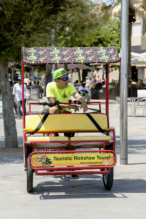 local 27: SPAIN, BARCELONA, JUNE, 27, 2015 - Bicycle rickshaw waiting for customers in Barcelonas street, Catalonia. Cycle rickshaw - very popular local transport. Editorial