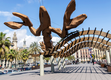 colom: SPAIN, BARCELONA, MARCH, 20, 2016 - Gambrinus- giant  happiest lobster sculpture with big pinching claws and a cheeky smile on Passeig de Colom at the Port Olympic, commissioned for the 1992 Barcelona Olympic Games.  in Barcelona, Catalonia, Spain