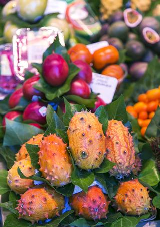 la boqueria: La Boqueria market with tropical fruits in Barcelona, Spain.  La Boqueria market, Europes largest and most famous food markets. Stock Photo