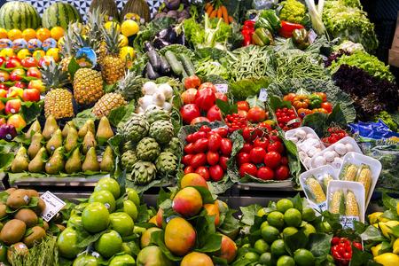 la boqueria: La Boqueria market with vegetables and fruits in Barcelona. Spain. La  Boqueria market, Europes largest and most famous food markets, Barcelona, Spain
