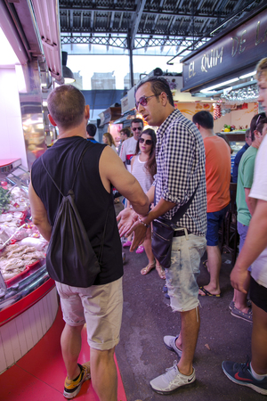 apprehended: SPAIN, BARCELONA, JUNE, 29, 2015 - Guard arrested the thief and put them handcuffed on the La Boqueria Market in Barcelona, Spain.  One of the oldest markets in Europe that still exist. Established 1217. Editorial