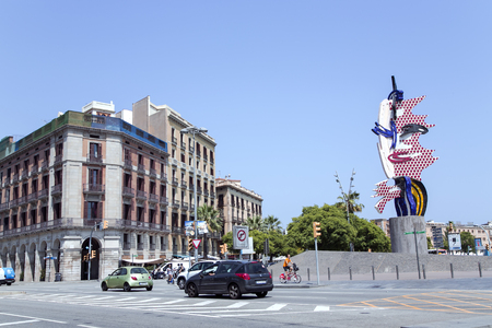 represents: SPAIN, BARCELONA, JUNE, 27, 2015 - Roy Lichtenstein Head sculpture in Barcelona, Spain. Represents the face of a woman. Made of concrete and ceramics, it is the ceramic cladding that pays homage to Barcelona and its famous son Antoni Gaudi. Editorial