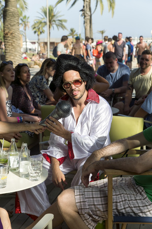 elvis presley: SPAIN, BARCELONA, JUNE, 27, 2015 - Costume party in the style of Elvis Presley on the Barceloneta beach in Barcelona, Catalonia, Spain.