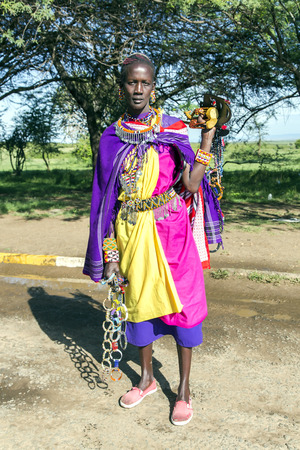northern african: AFRICA, TANZANIA, MAY, 06, 2016 - African woman of the Masai tribe sells ornaments made of beads. The Maasai (also called Masai) are an indigenous African ethnic group of semi-nomadic people located in Kenya and northern Tanzania.