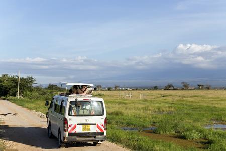 rift: AFRICA, KENYA, MAY, 05, 2016 - Visitors on jeep shoot near Mount Kilimanjaro in Amboseli National Park at Rift Valley Province of Kenya.