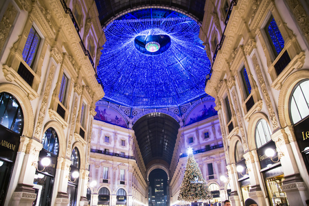 ITALY, MILAN, DESEMBER, 23, 2015 - Bottom view on the glass dome during Christmas in shopping mall the Galleria Vittorio Emanuele II, named after the first king of the Kingdom of Italy. Milan, Italy Editorial