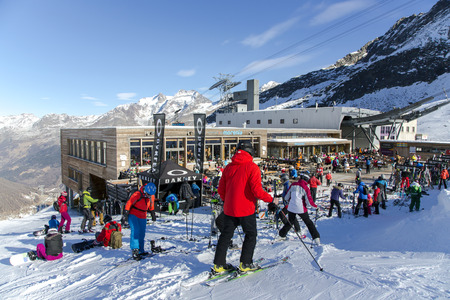 december 25: SWITZERLAND, SAAS-FEE, DECEMBER, 25, 2015 - View of the popular ski restaurant Morenia with sun-terrace is located directly at the ski run of the Felskinn snow sports area at an altitude of 2550 m near Saas-Fee, Switzerland.
