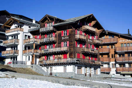 Saas Fee: SWITZERLAND, SAAS-FEE, DECEMBER, 26, 2015 - Modern wooden hotels on a bright sunny day in the charming Swiss resort of Saas-Fee, Switzerland.