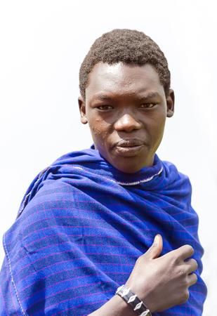 spelled: AFRICA, KENYA, MAY, 08, 2016 - Maasai Mara tribe men in a blue cape at Maasai Mara National Park, Kenya, Africa. The Maasai (sometimes spelled Masai) are a Nilotic ethnic group of semi-nomadic people inhabiting southern Kenya and northern Tanzania. Editorial