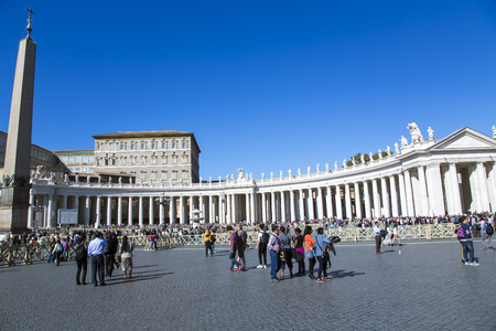 ITALY, VATICAN CITY, OCTOBER, 28, 2014 - Area before Papal Basilica of Saint Peter.The area is framed by a semicircular colonnade designed by Bernini, forming together with the cathedral form a symbolic Key St. Peter.