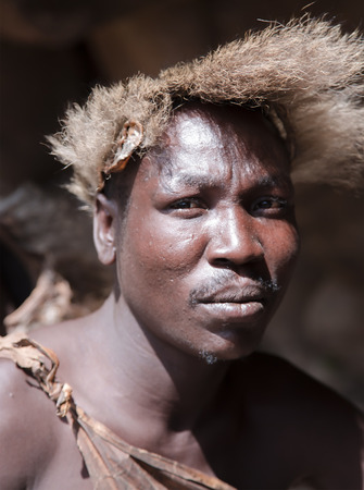 AFRICA, TANZANIA, MAY, 10, 2016 - loseup portrait tribesman of the hadza tribe, disappearing ethnic group in Tanzania, Africa